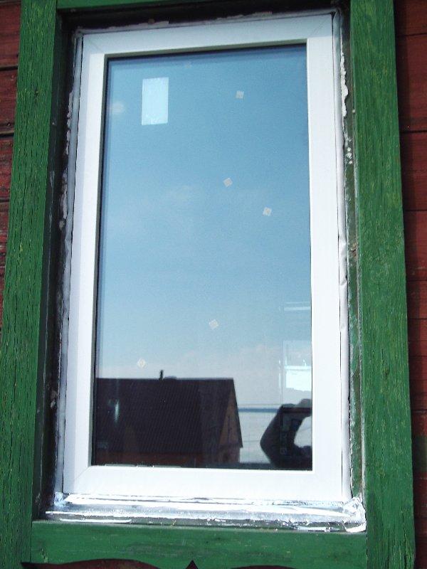 Окна в доме из клееного бруса